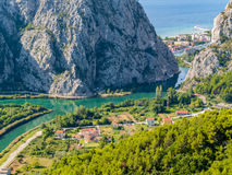 River Cetina. Estuary of the river Cetina. The dalmatian city Omis is visible through the ravine stock images