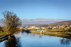 River Cetina and small dalmatian town Trilj, Croatia. River Cetina is one of main rivers in Dalmatia region. In the background is located small nice town called royalty free stock images