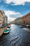 River channel with boat in Saint Petersburg Royalty Free Stock Images