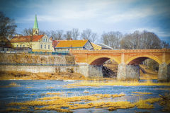 River,Church and old red stone bridge Stock Image