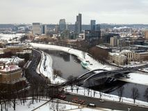 River in the city. The bridge, river and the city in winter time Royalty Free Stock Images