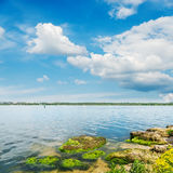 River and clouds in blue sky Stock Photos