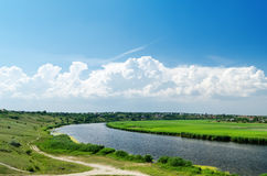 River and clouds with blue sky Stock Image