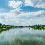 River and clouds in blue sky Royalty Free Stock Image