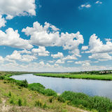 River and clouds over it in blue sky Royalty Free Stock Photography