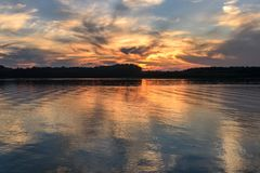 River clouds sky sunset reflections Royalty Free Stock Images