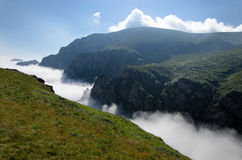 River of clouds. Temperature inversion creates a river of clouds Stock Photos