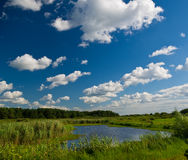 River and cloudy blue sky Royalty Free Stock Photography