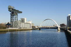 River Clyde in Glasgow. View of River Clyde, Glasgow, Scotland, UK, Europe. Image features Squinty Bridge, known as the Clyde Arc, and the Clydeport crane Royalty Free Stock Images
