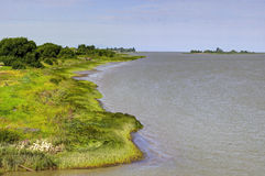 River coastline extending to the sea Stock Photos