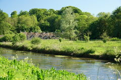 River Coln in Bibury. Cotswold, United Kingdom-May 26, 2017:Bibury is a village in Gloucestershire, England. The village is known for its honey-coloured Stock Photos