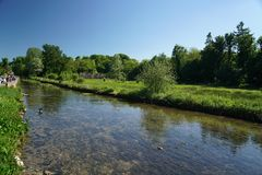 River Coln in Bibury. Cotswold, United Kingdom-May 26, 2017:Bibury is a village in Gloucestershire, England. The village is known for its honey-coloured Stock Image