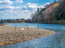 River in autumn in Arashiyama, Japan. River with colorful leaves in autumn season in Arashiyama region, Kyoto, Japan Stock Image