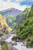 River coming through a valley, Annapurnas area, Himalayas, Nepal. View from the trekking at Annapurnas circuit, Nepal Stock Photography