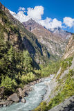 River coming through the valley between great mountains. View from the trekking at Annapurnas circuit, Nepal Royalty Free Stock Photography