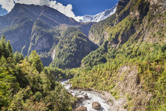 River coming through the valley between great mountains. View from the trekking at Annapurnas circuit, Nepal Stock Photography