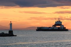 River Container Barge at Sunset, Vancouver Royalty Free Stock Images
