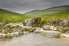 River Coquet cascades down Coquetdale Stock Image