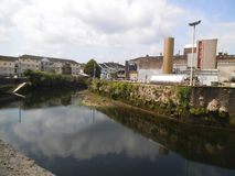 A river in cork with industry buildings in the background. stock photos