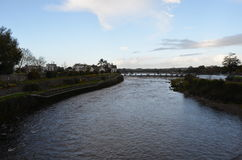 River Corrib and Dam near a Cathedral in Galway, Ireland royalty free stock photo