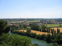 River and countryside. The River Orb, in Languedoc, France. A view with trees in the foreground, and the river is flanked by trees on the opposite bank, and the Royalty Free Stock Photography