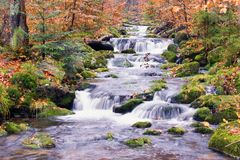 River in countryside. Scenic view of picturesque river with small waterfalls in Autumnal countryside Royalty Free Stock Image