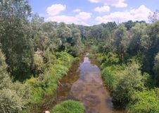 River in countryside. River surrounded by vegetation in countryside royalty free stock images