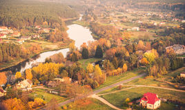 River and countryside. Houses and and river in countryside from above. Lithuania near Nemencine Royalty Free Stock Photo