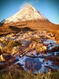At river Coupall at delta to river Etive. Snowy cone of mountain Stob Dearg 1021 metres high. Royalty Free Stock Image