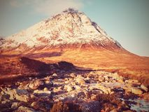At river Coupall at delta to river Etive. Snowy cone of mountain Stob Dearg 1021 metres high. Royalty Free Stock Photography