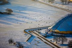 River covered with ice and snow in the downtown stock images