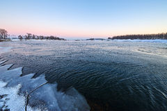The river and covered with ice sunset Stock Image