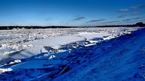 River covered with piles of ice smithereens royalty free stock images