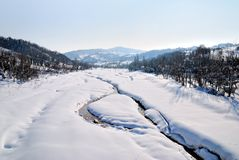 River covered by the snow in winter in the morning Royalty Free Stock Image