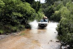 River Crossing in offroad vehicle. A 4x4 vehicle crossing a river in the wilderness Royalty Free Stock Photos
