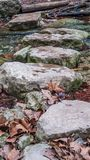 River crossing path of flat rocks across water of a river stream stock photography