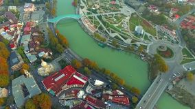 River crossing Tbilisi`s centre, aerial stock video