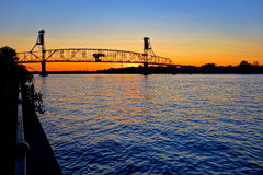 River Crossing Transportation Bridge at Sunset Stock Images