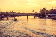 The River cruise boats transporting people on the Mae Klong River. This is a very popular tourist attraction in the city. River cruise boats transporting people royalty free stock photos