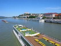 River cruise on Danube, Bratislava, people. People travel on Danube river on large cruise ship. They looking at panorana of Bratislava city. On hill above the stock photography
