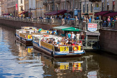 River cruise passenger boats moored on Griboedov channel in St. Royalty Free Stock Photo