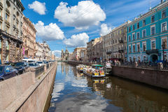 River cruise passenger boats moored on Griboedov channel in St. Stock Image