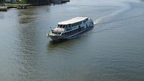 A river cruise ship goes upstream on Chao Phraya River stock video footage