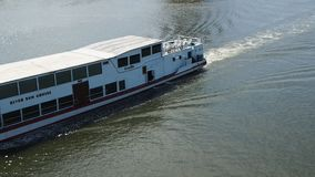 A river cruise ship goes upstream on Chao Phraya River stock video