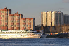 River cruise ship on the river Neva. ST.PETERSBURG, RUSSIA - APRIL 15, 2014: River cruise ship on the river Neva, outskirts of St. Petersburg Stock Photos
