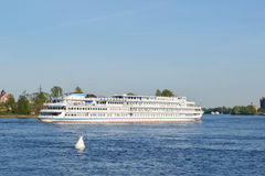 River cruise ship sailing on the river Neva Stock Images