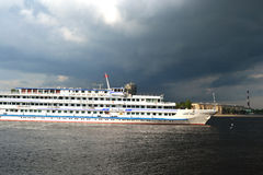 River cruise ship sailing on the river Neva Stock Photography