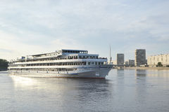 River cruise ship sailing on the river Neva. Royalty Free Stock Photography