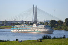 River cruise ship sailing on the river Neva. ST.PETERSBURG, RUSSIA - JULY 20, 2014: River cruise ship sailing on the river Neva, outskirts of St. Petersburg Royalty Free Stock Images
