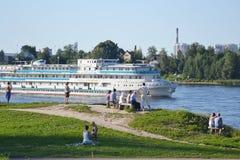 River cruise ship sailing on the river Neva. ST.PETERSBURG, RUSSIA - JULY 20, 2014: River cruise ship sailing on the river Neva, outskirts of St. Petersburg Stock Images